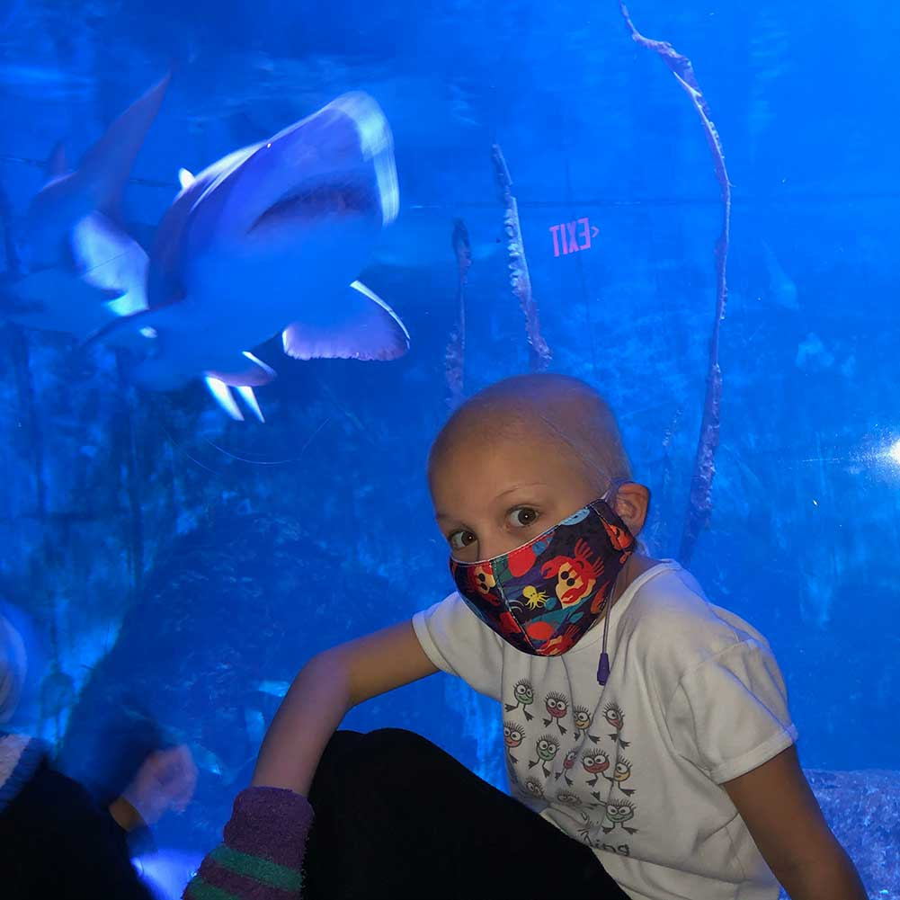 Avery and her family visits the aquarium.